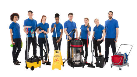 Group Of Happy Janitors With Cleaning Equipment