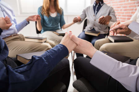 Close-up Of People Holding Each Others Hand Praying Together Stock Photo - 79443277