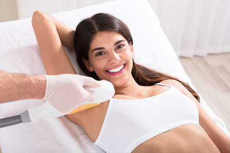 Young Woman Having Underarm Laser Hair Removal Treatment In Beauty Spa Clinic Stock Photo - 79459114