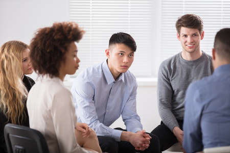 large group of business people: Happy Young Multiracial Businesspeople In Meeting At Office