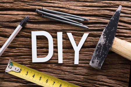 High Angle View Of DIY Text With Worktools On Wooden Table Stock Photo