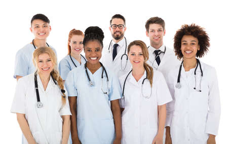Portrait Of Smiling Multiracial Medical Team In Front Of White Background Banco de Imagens - 80396406