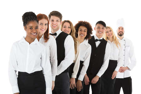 Happy Confident Restaurant Staff Standing In Row Against White Background Stok Fotoğraf