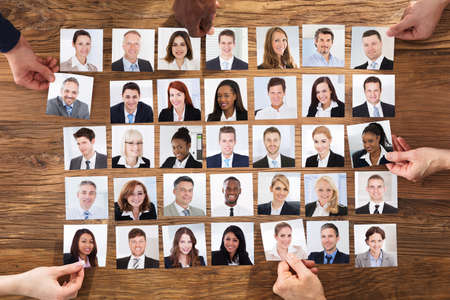 Businesspeople Hand Selecting The Candidate Portrait Photo For Hiring In Job photo