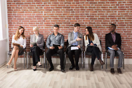 jobless: Group Of People Waiting For Job Interview In Office