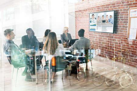 Group Of Businesspeople Having Video Conference In Boardroom 版權商用圖片 - 80832057