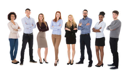 large group of business people: Portrait Of Happy College Students Standing Against White Backgrounds Stock Photo