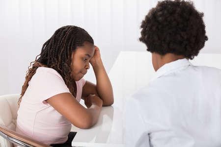 Portrait Of Female Doctor Comforting Depressed Patient