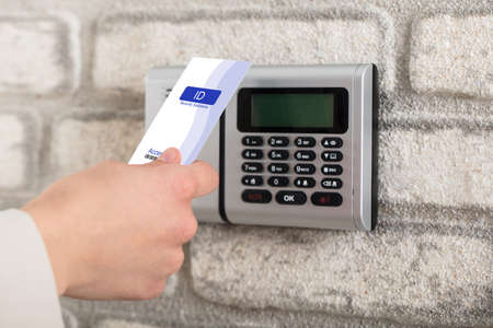 keycard: A Persons Hand Holding Access Card To Lock And Unlock Door