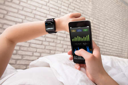 Woman's Hand Showing Heart Rate On Smart Watch And Cell Phone Stock Photo - 82032796