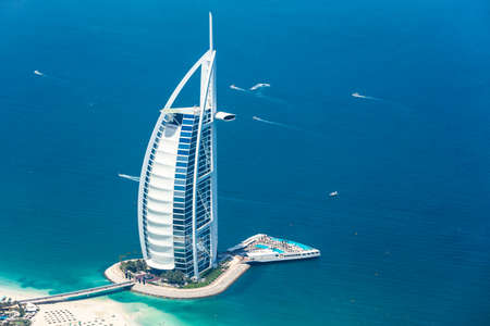 DUBAI, UAE - MAY 20: Burj Al Arab luxury 5 star hotel on May 20, 2017 in Dubai, UAE. Burj Al Arab is the third tallest hotel in the world and stands on an artificial island. Aerial view