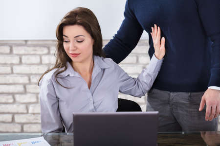 Young Woman Defending Herself For Sexual Harassment In Business Office Reklamní fotografie - 82969290