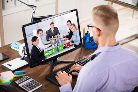 Close-up Of A Businessman Video Conference With Her Colleagues On Computer In Office