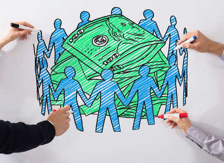 Close-up Of Business Peoples Hand Drawing Crowd Funding Chart With Marker On Whiteboard