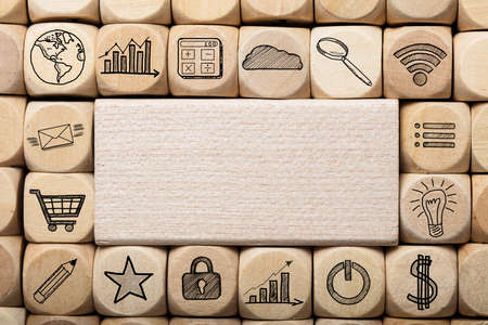Full frame shot of wooden block surrounded by various computer icons Stock Photo
