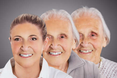 Multiple image showing ageing process of woman over gray background Editorial