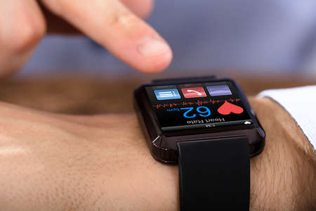 Person Hand Wearing Smart Watch Showing Heartbeat Rate Stock Photo