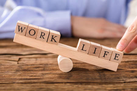 Close-up Of A Persons Finger Showing Misbalance Between Work And Life Stock Photo