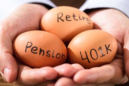 Close-up Of A Human Hand With Brown Egg Showing Pension And Retirement Text Stock Photo - 84537927