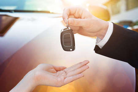Mans Hand Placing The Cars Key On Hand