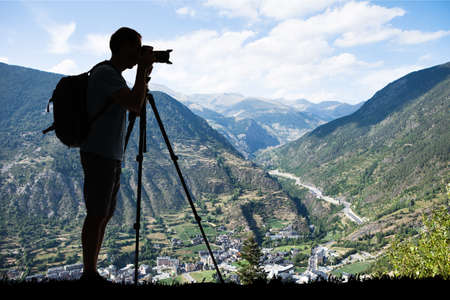Silhouette Of A Man With Backpack Photographing During Winter Using A Tripod