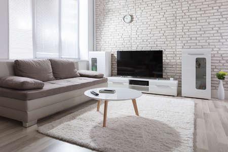 contemporary living room: Interior Photo Of Modern Sunny Living Room Stock Photo