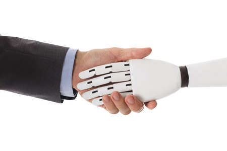 Close-up Of Businessperson Shaking Hands With Robot Reklamní fotografie - 86387064