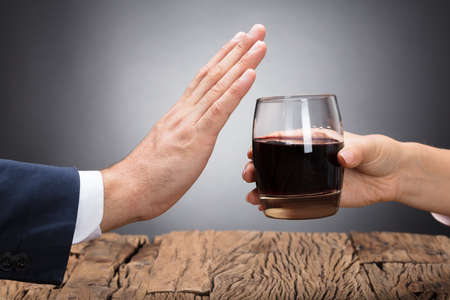 Businessperson Rejecting Glass Of Whiskey Offered By Colleague Reklamní fotografie