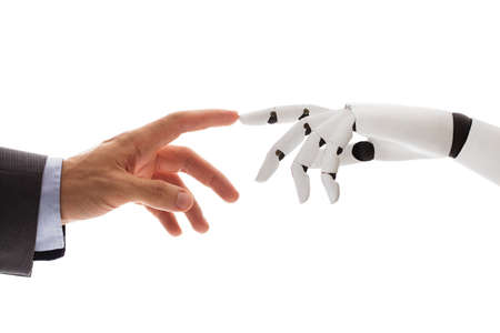 Close-up Of Businessperson Finger Touching Robotic Finger Over White Background