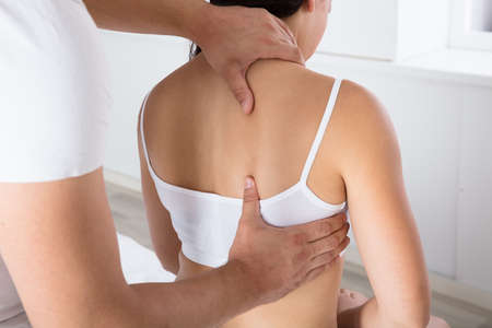 Close-up Of A Woman Receiving Back Massage At Beauty Spa Stock Photo