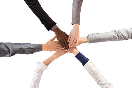 Group Of Multi Ethnic Business People Stacking Hands Against White Background Stock Photo