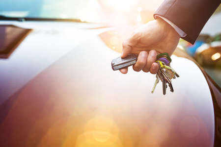 selling service: Detail Of A Mans Hand Opening His Car With The Control Remote Key