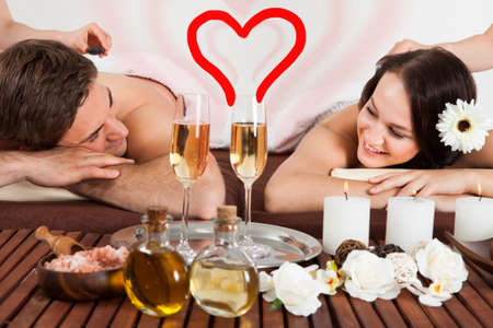 Young Happy Couple Receiving Massage In Spa