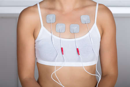 Close-up Of A Woman Having Electrotherapy On Chest Stock Photo