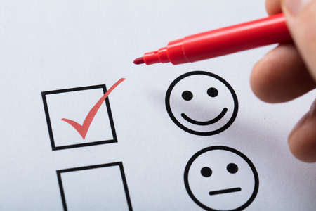 Persons Finger With Pen Over Customer Service Satisfaction Survey Form