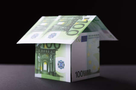 Close-up Of A House Made Up Of Banknote On Black Background Lizenzfreie Bilder