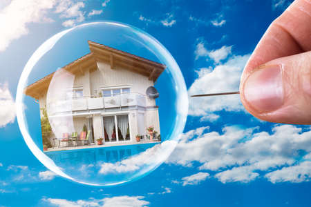 Human Hand Poking House And Bubble With Needle Against Cloudy Sky Stok Fotoğraf - 92344430