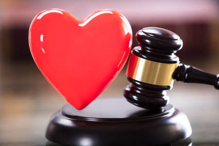 Close-up Of Red Heart And Gavel In Courtroom