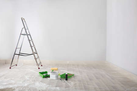 Freshly Painted White Room With Ladder And Painting Equipments At Home