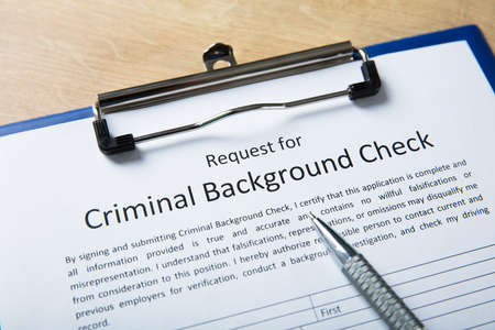 High Angel View Of Criminal Background Check Application Form With Pen
