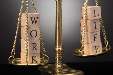 Close-up Of Golden Justice Scale With Wooden Blocks Showing Work And Life Text