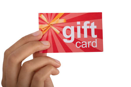 Close-up Of Persons Hand Holding Gift Card Against White Background
