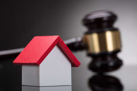 Close-up Of A House Model In Front Of Gavel