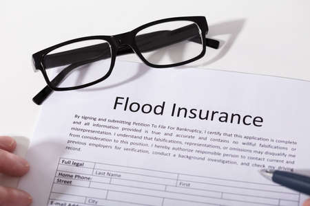 Elevated View Of Flood Insurance Form And Spectacles Standard-Bild
