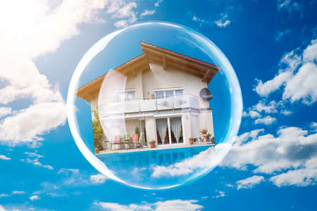Close-up Of House Inside Bubble Against Cloudy Sky Standard-Bild