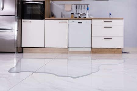 Close-up Of Spilled Water On Kitchen Floor At Home Reklamní fotografie
