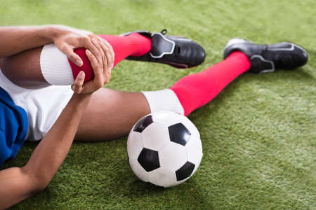 Close-up Of An Injured Male Soccer Player On Field Stock Photo