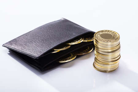 Wallet And Golden Coins On White Background