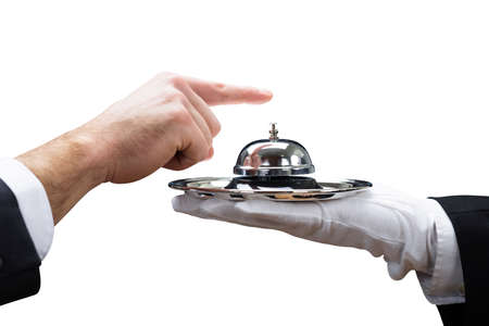 Customers Hand Ringing Service Bell Held By Waiter On White Background