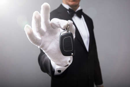 Close-up Of A Waiters Hand Holding Car Key Stock fotó